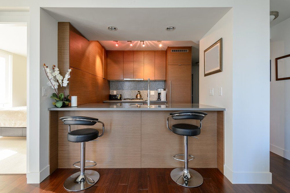 Bright modern kitchen with leather bar stools. Interior design.