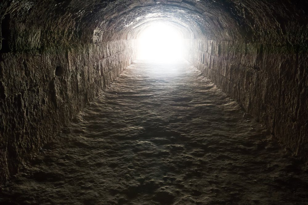 Light in the end of the tunnel. Hope and freedom