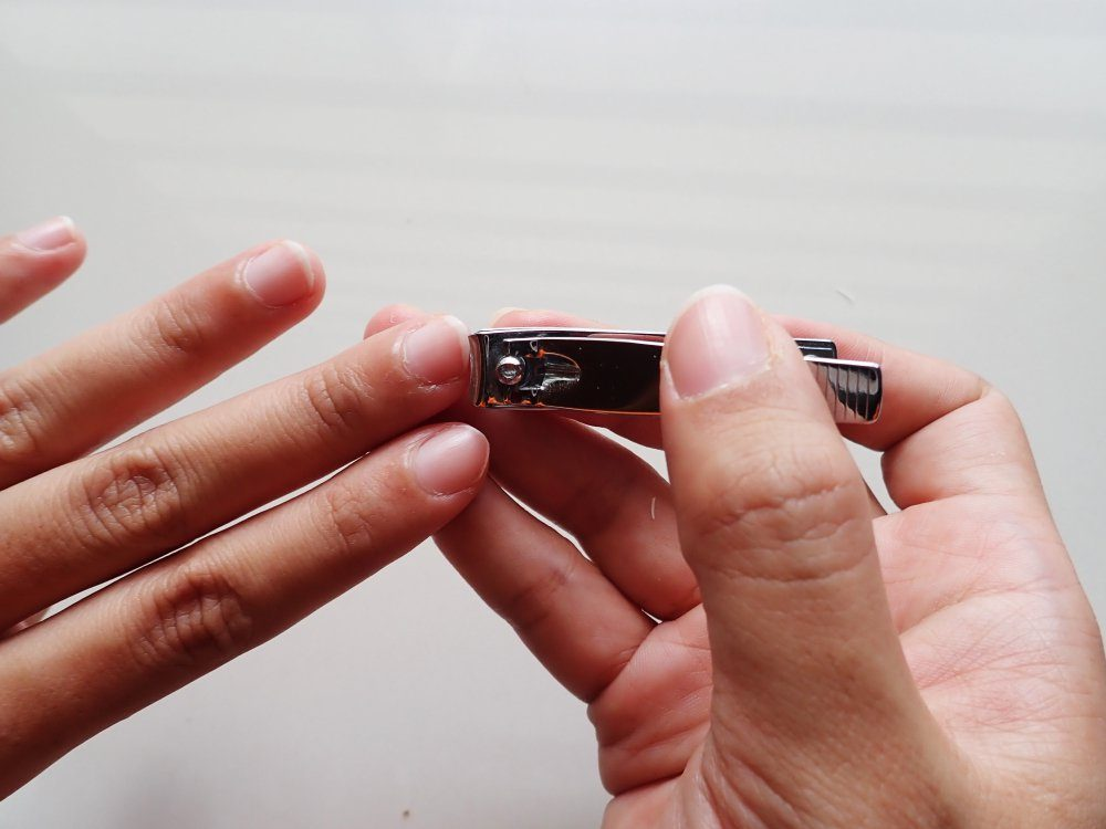 Cutting your nails with clipper
