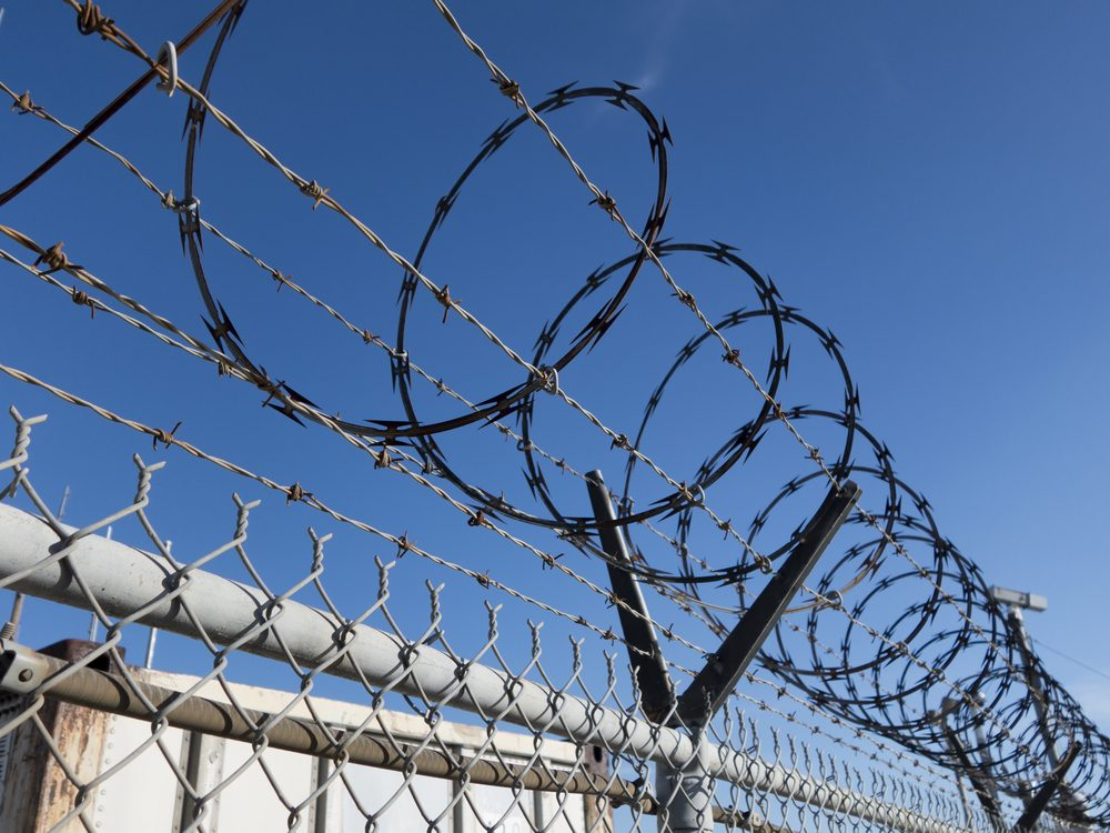 Barbed wire in prison yard