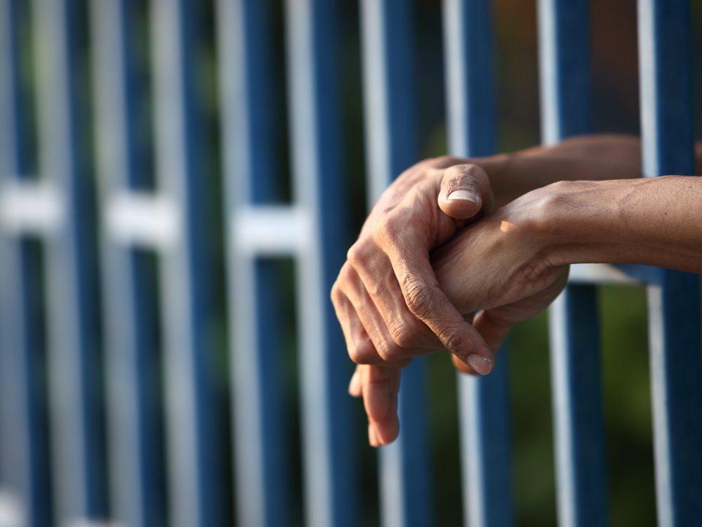 Close-up of prisoner's hands
