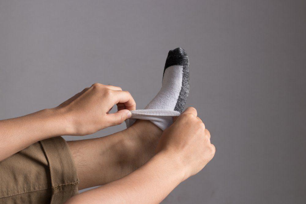 Hand putting on socks
