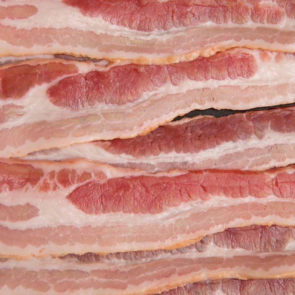 A Background of American Style Bacon in a Pan