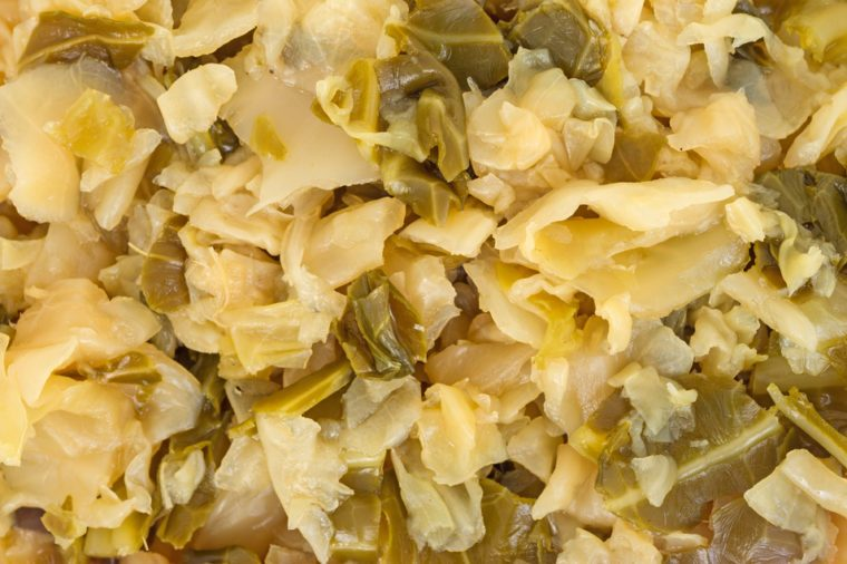 A very close view of shredded and seasoned cooked cabbage.