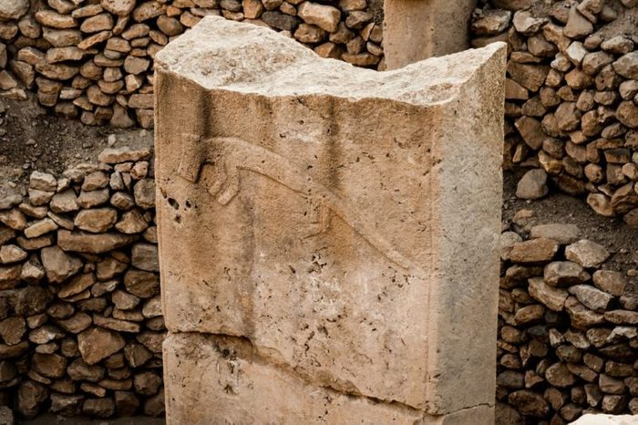 Stylised carvings at Gobekli Tepe archaeological site at the top of a mountain ridge in the Southeastern Anatolia Region of Turkey.