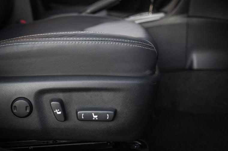 Detail of new modern car interior, Focus on seat adjust switch