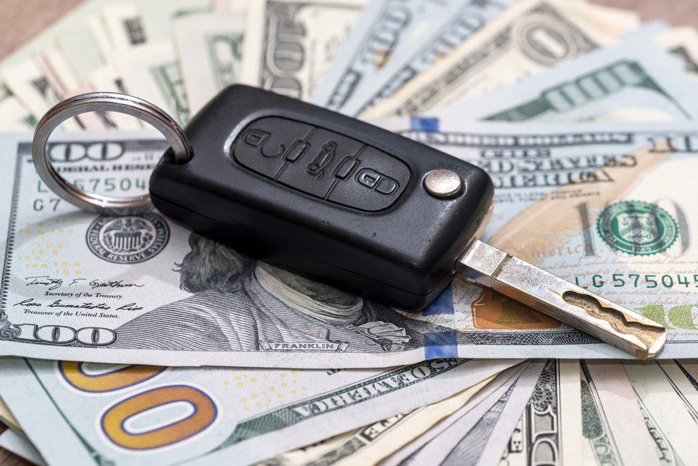 car key on dollar bills
