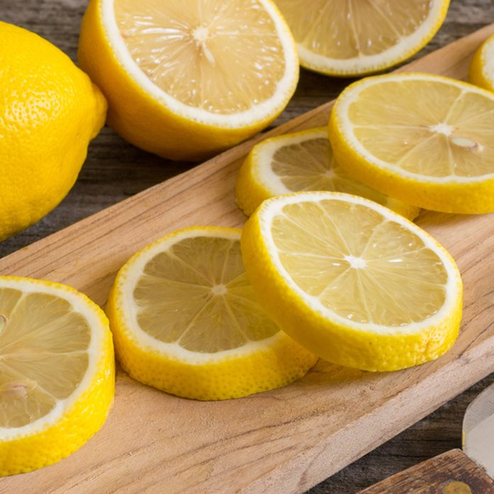 Lemon slices on the old wooden table.; Shutterstock ID 585968516