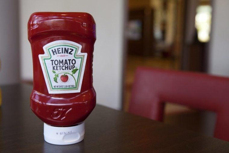 MIAMI BEACH, FLORIDA, JUNE 25, 2017: Bottle of Heinz Ketchup in Restaurant