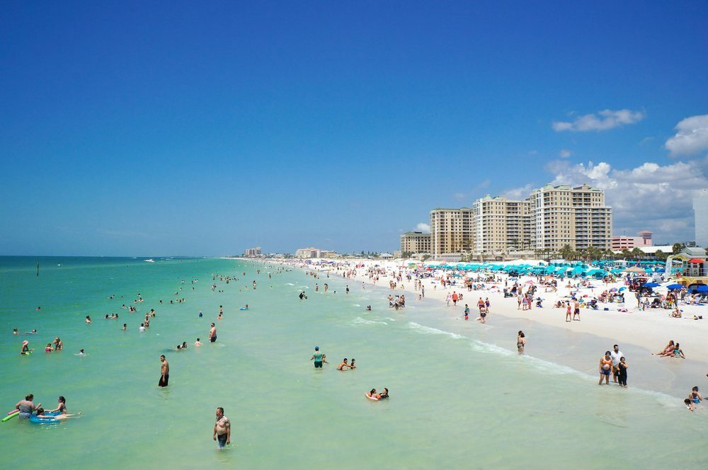 People enjoying water and beach and skyline in Clearwater Beach Florida, Spring Break, April 23, 2017