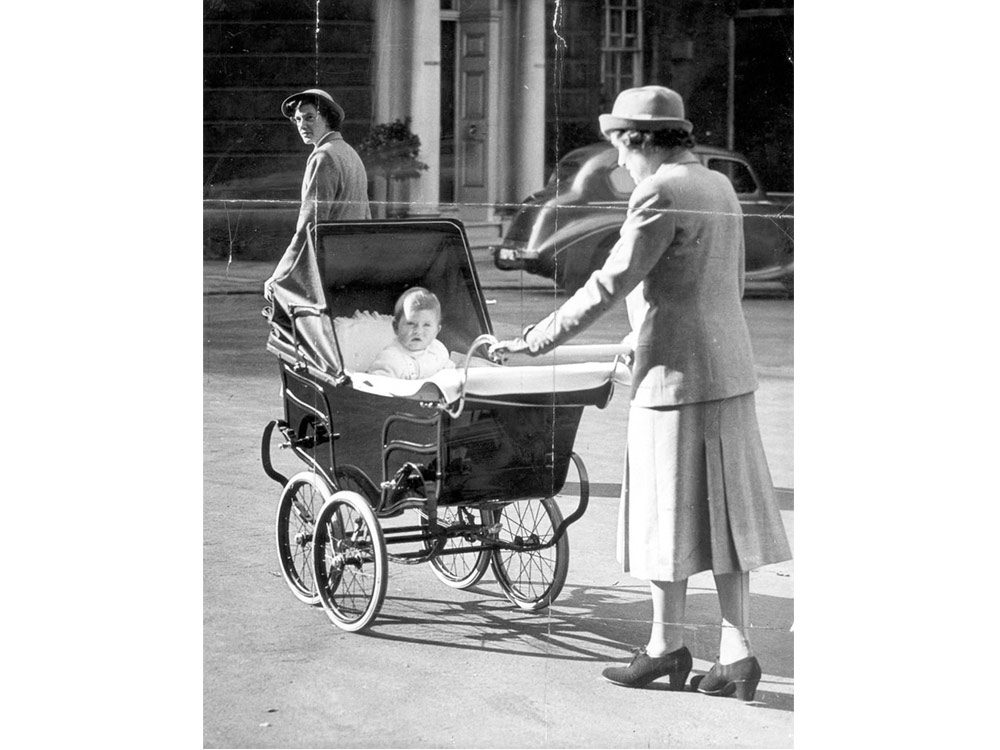 Prince Charles as a baby in a pram