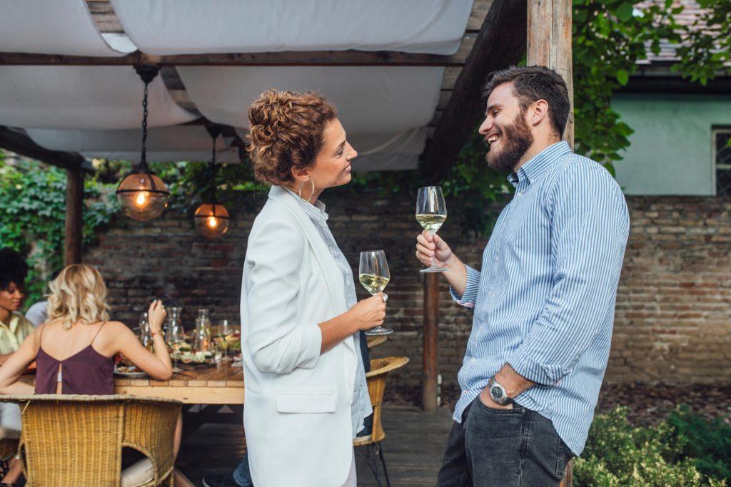 friends couple talk party wine