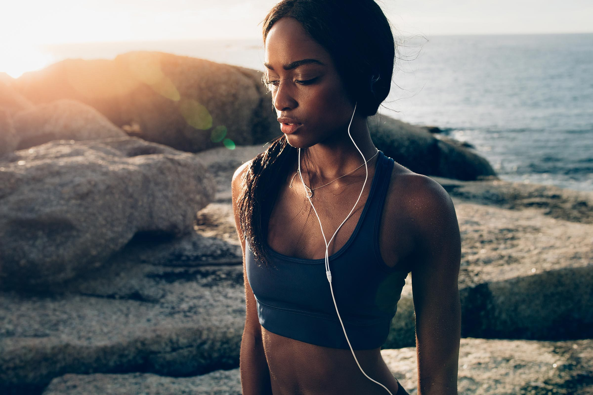 woman fitness sun flare ocean