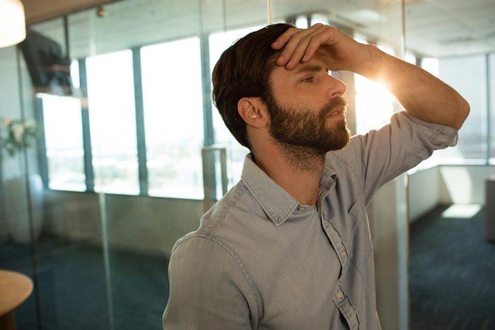 man headache sun flare