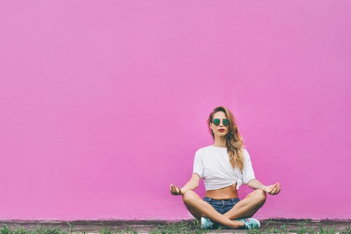 how to improve your memory every day - woman meditate wall