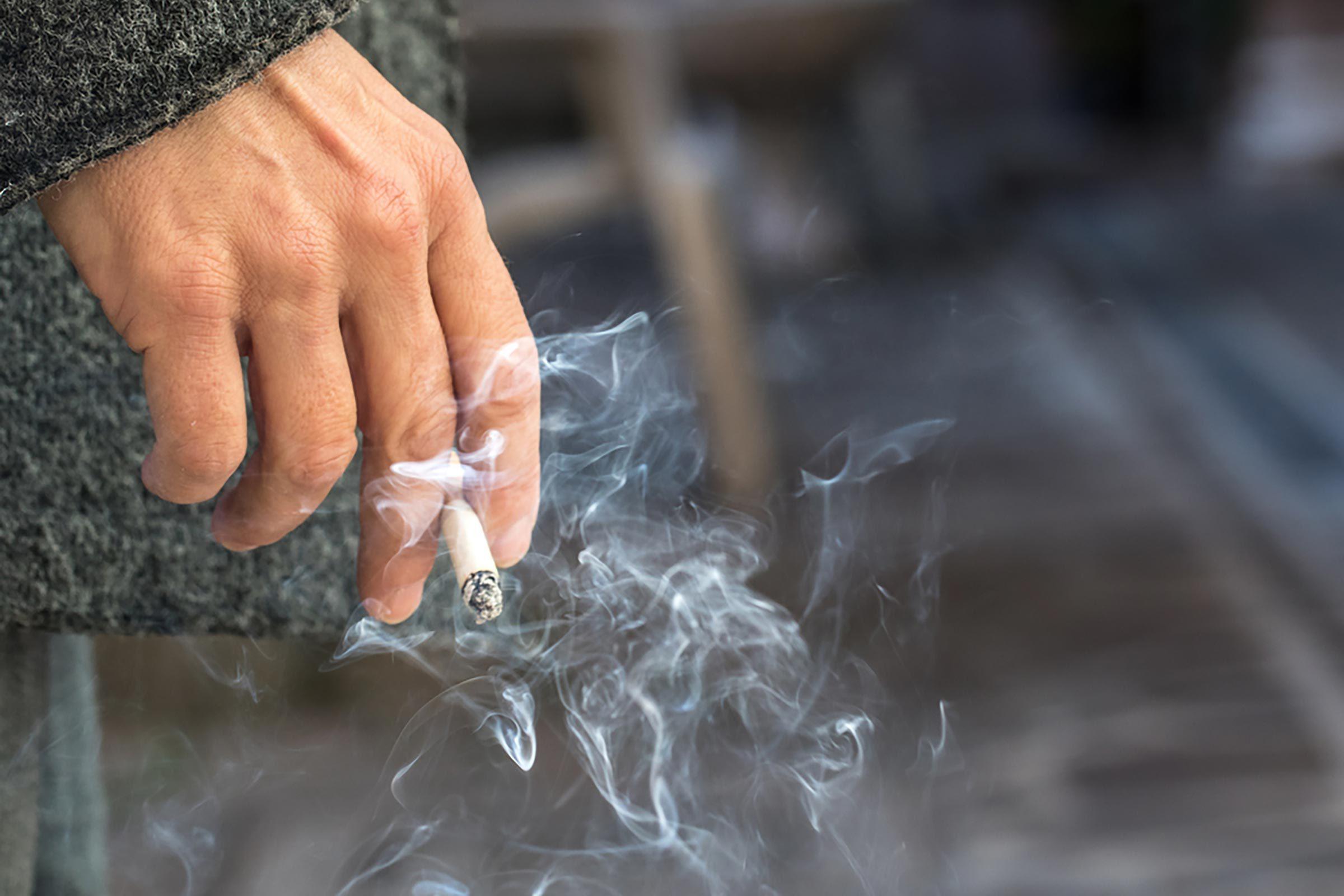 personholdingcigarette