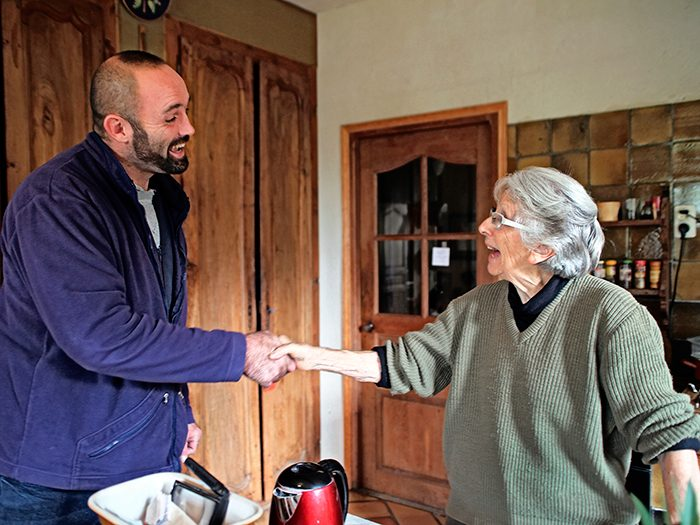 Postman Nicolas Dezeure visits Janine, who lives alone in rural France.