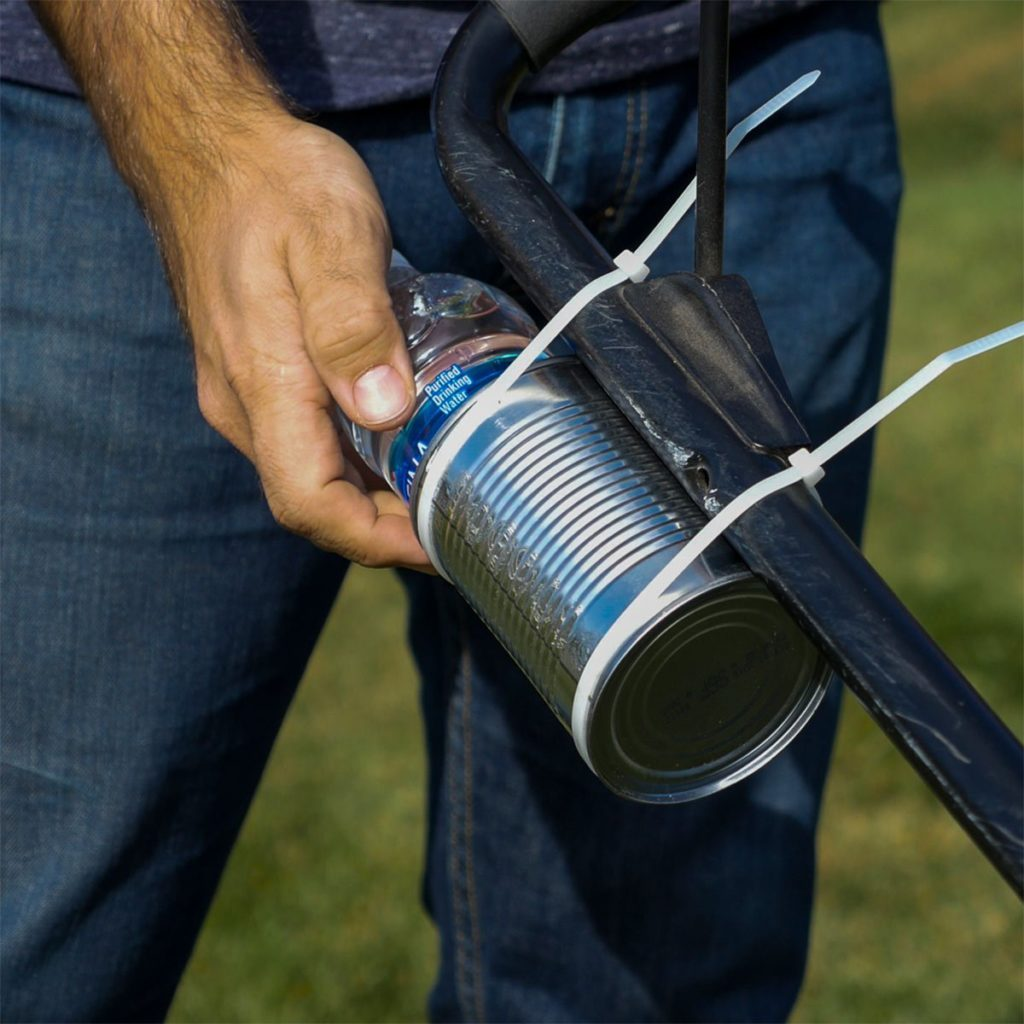 placing water bottle in tin can holder