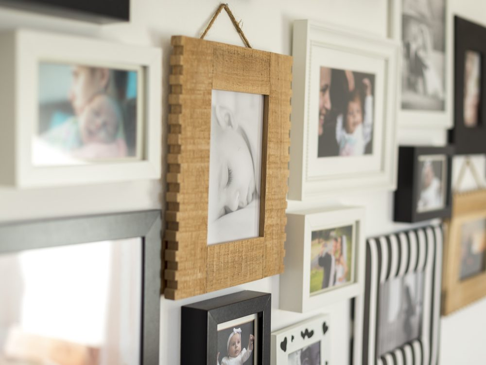 Family photos nailed on wall