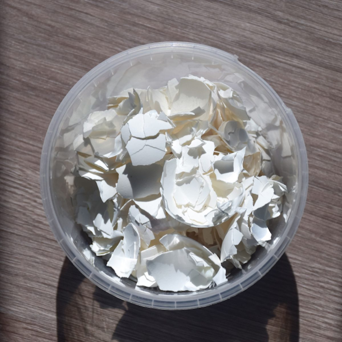 Egg shell on the table. Calcium carbonate, found naturally in the form of minerals, is part of the egg shell. Used in everyday life to alkalize the soil in gardening.