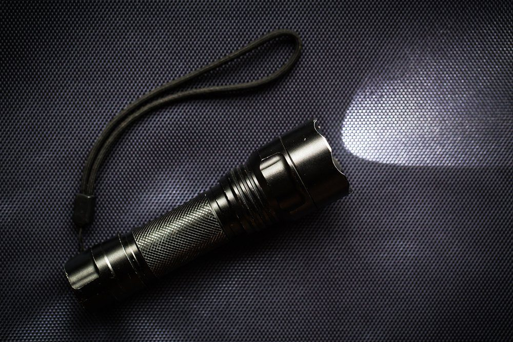 LED flashlight with a light beam for hiking at night