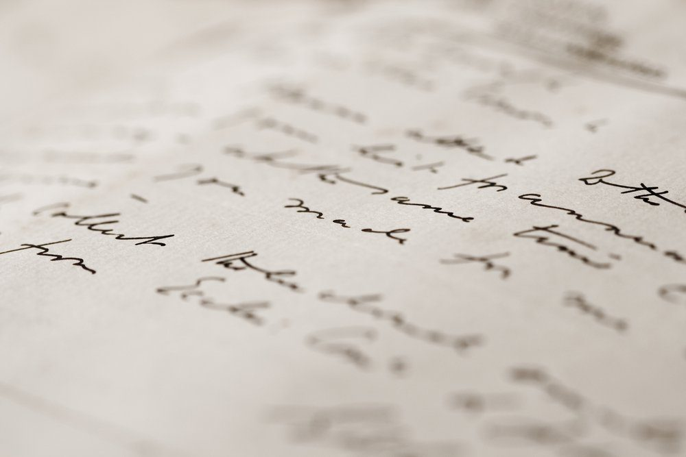 A close up with a narrow depth of field of a hand-written letter