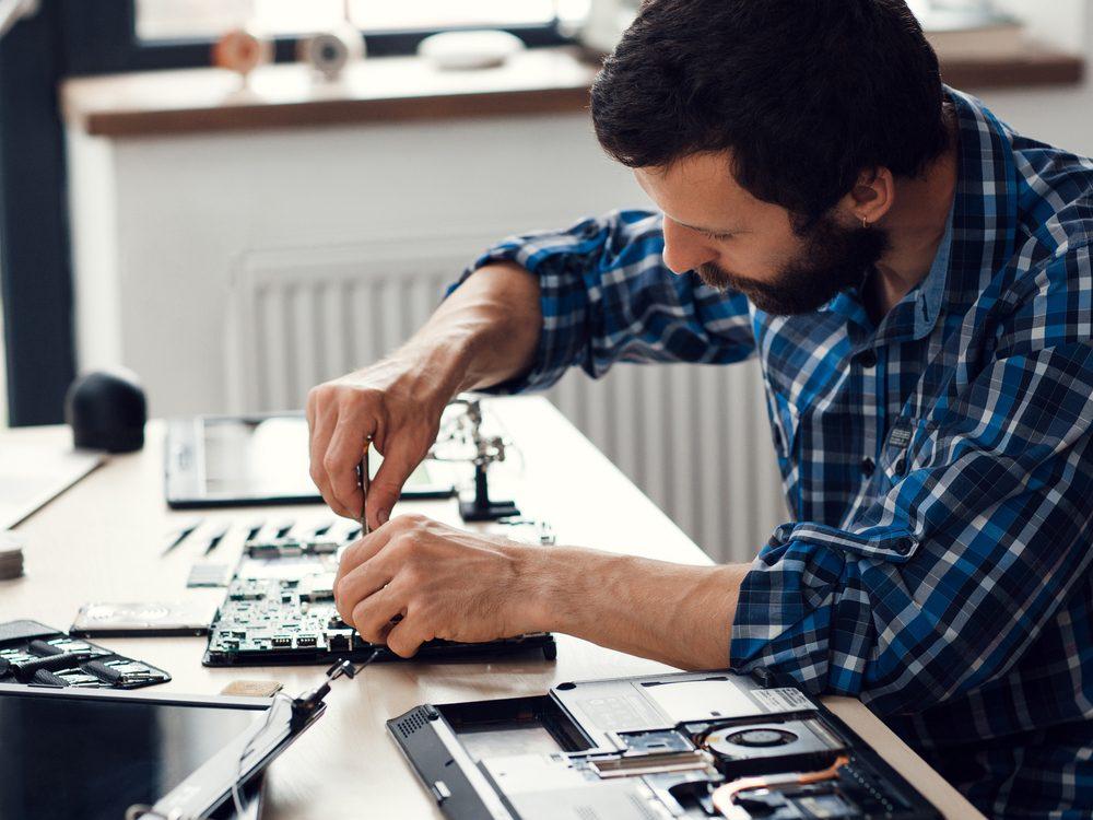 Engineer fixing broken computer motherboard