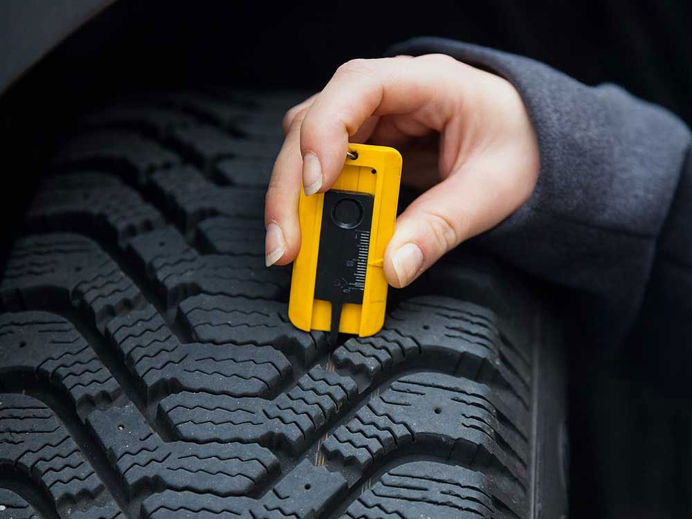 How to maintain car tires - use a tread depth gauge