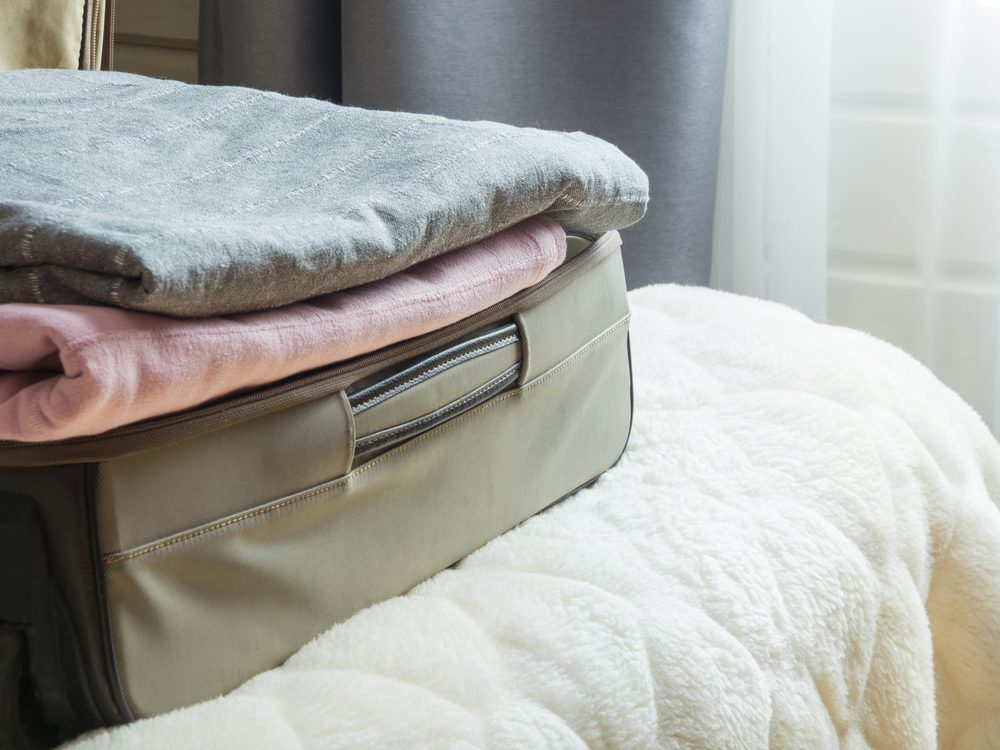 Luggage on bed