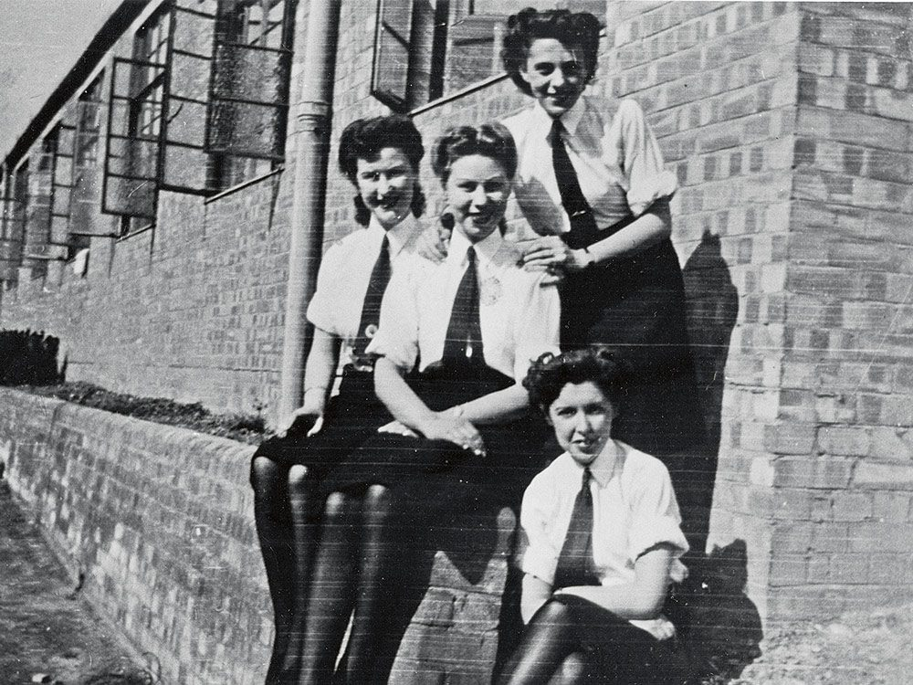 Janes, at left, sitting with fellow Wrens outside their quarters in Stanmore, London