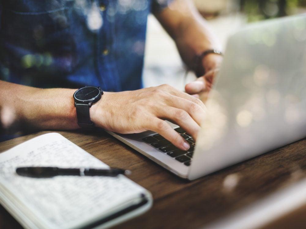 Man using laptop at cafe