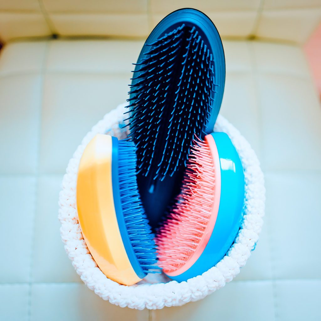 Basket with combs and round hair brushes. Toned image. Comb for combing raw hair in a basket in a hair salon. close up view; Shutterstock ID 1028801134; Job (TFH, TOH, RD, BNB, CWM, CM): TOH