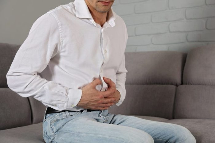 Man with stomach pain. Digestive system, Urinary Tract Infection