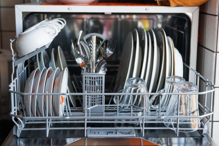 Small dishwasher full of clean dishes