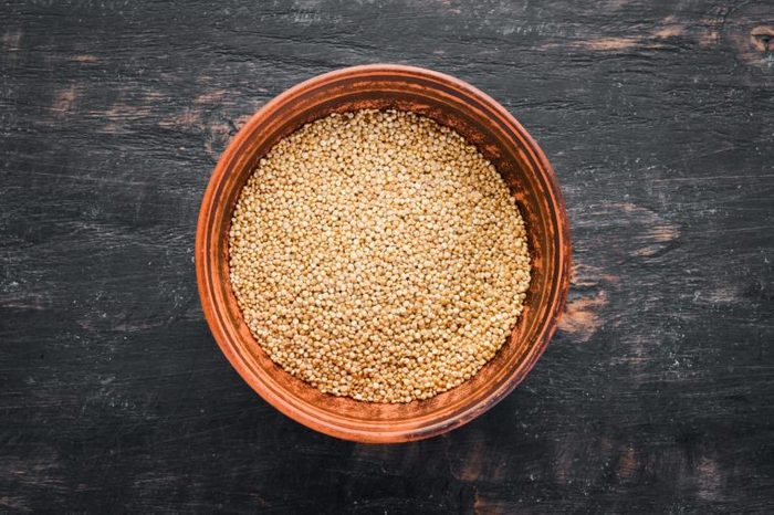 Raw white quinoa. On a black background. Top view. Free copy space.