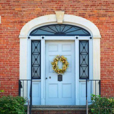 Curb appeal - wreath on front door brick home