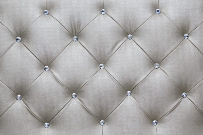 White couch cushions, background patterns.