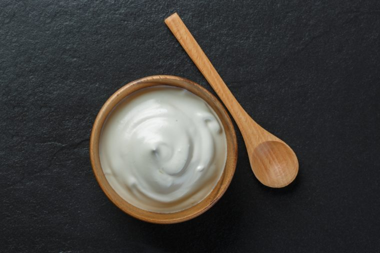 Greek yogurt on black stone background
