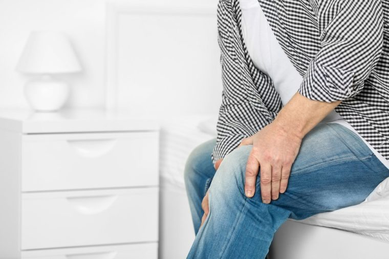 Mature man suffering from pain at home