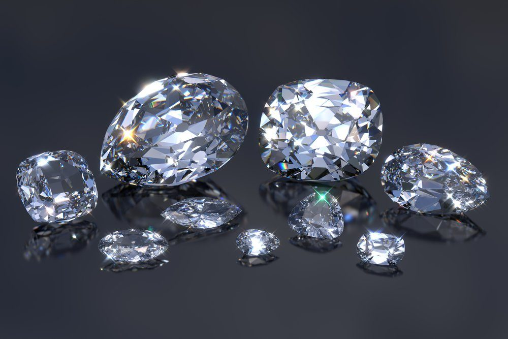 Nine main biggest Cullinan diamonds with reflections on black mirror background. British crown jewels, Cullinan I Great Star of Africa and others. Close-up view. 3D rendering illustration