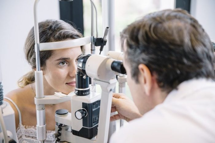 Eye Doctor examinating a young patient