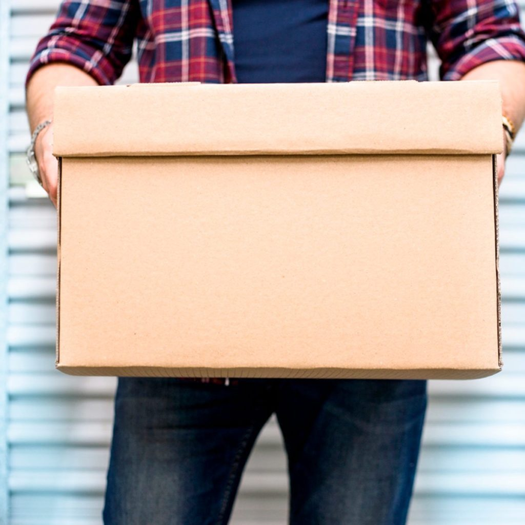 Man carrying a cardboard box