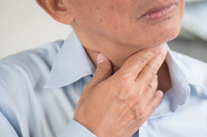 sick old man with sore throat, laryngitis, reflux