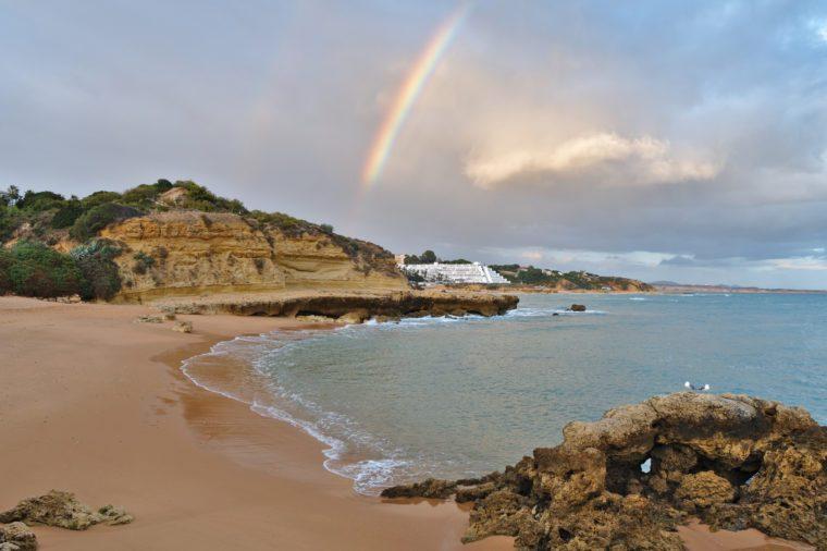 Beautiful Rainbow sight in Aveiros beach. Albufeira, Algarve, Portugal