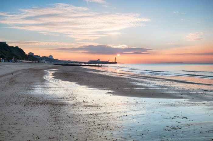 Sunrise over Bournemouth beach with the pier in the distance