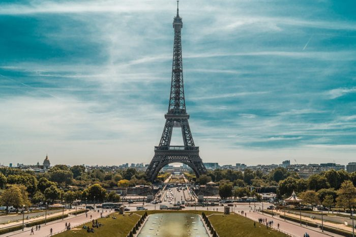 The Eiffel Tower is a wrought iron lattice tower on the Champ de Mars in Paris, France. It is named after the engineer Gustave Eiffel, whose company designed and built the tower.