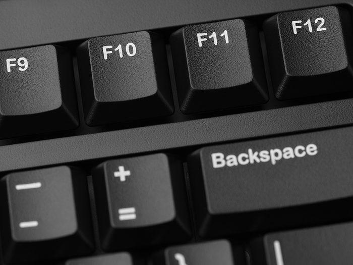 function of f1 to f12 keys in keyboard - Function keys of black computer keyboard (F9, F10, F11, F12). Closeup.