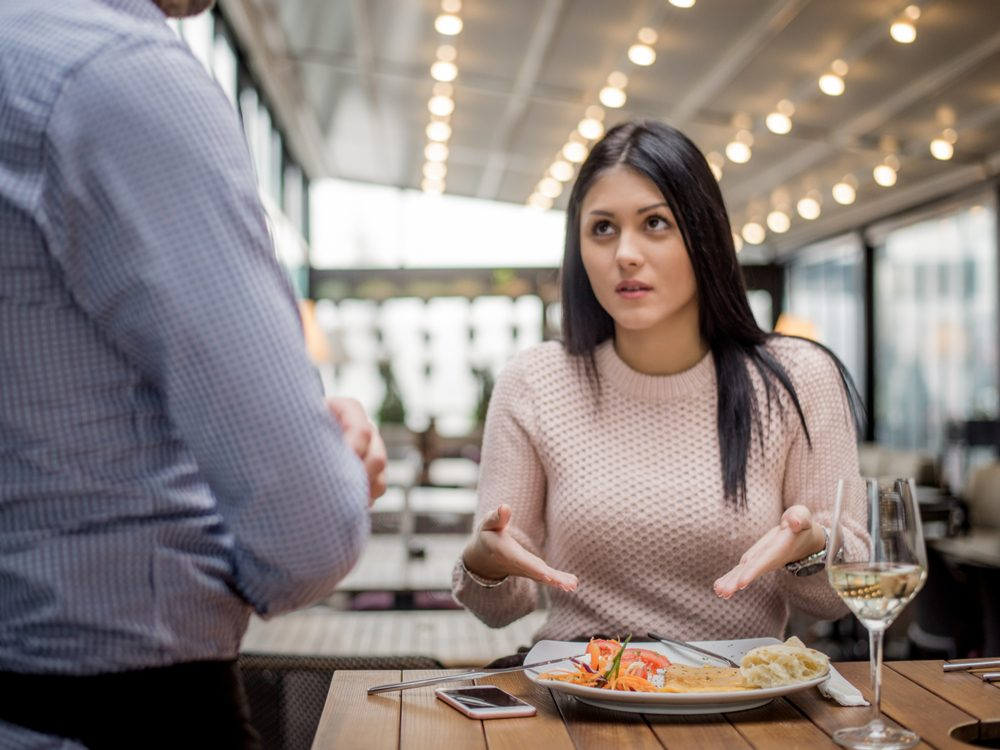 Woman disagreeing with her waiter
