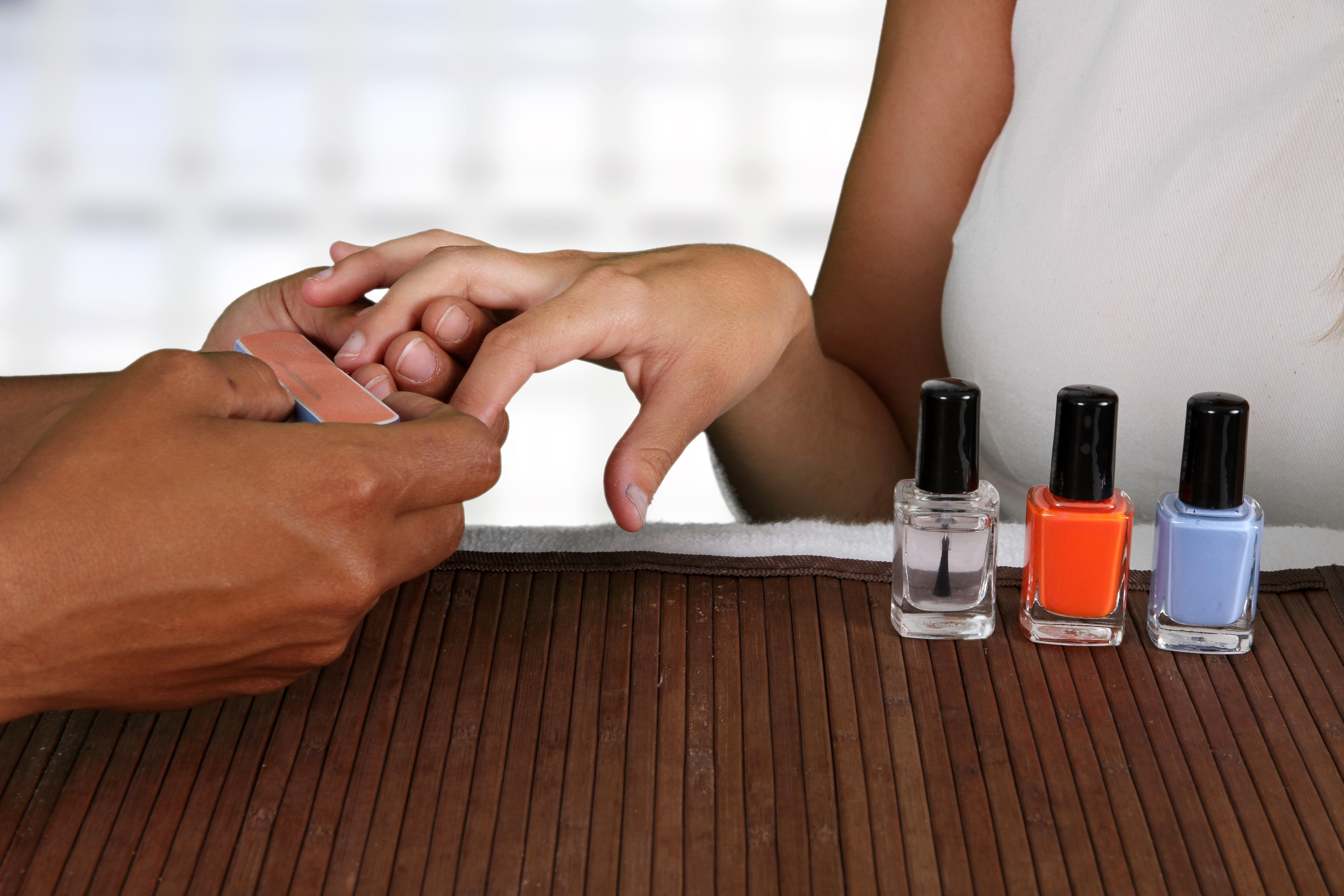 Woman getting her nails done at a spa