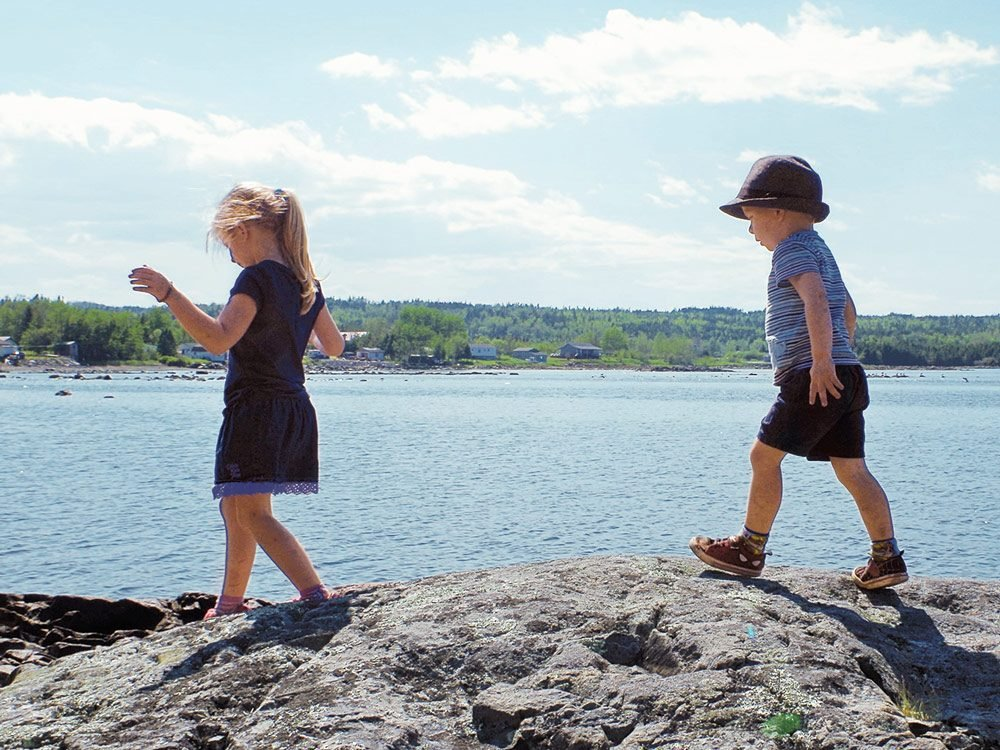 Charlotte and Oliver exploring the Cambellton shoreline